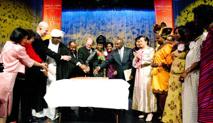 African Union, UN and UPF representatives with the celebration cake for the 48th Africa Day in New York